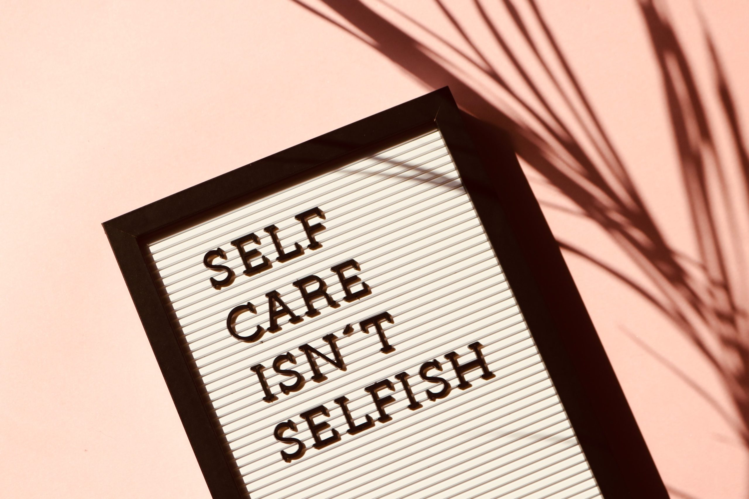 Letterboard stating that self-care isn't selfish.